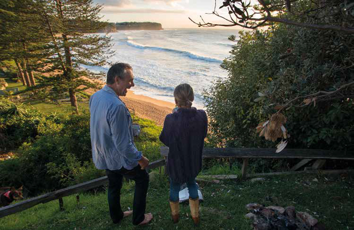 Dirk Hofman and Godelieve  Hofman-Verkuyl in the backyard, Bilgola Headland in the background. Photo: Bruce Usher